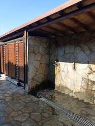 Modern public toilet and showers in the destroyed antique city of Faselis in the south of Turkey