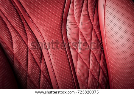 Modern race car  red perforated leather interior. Part of  leather car seat details.
