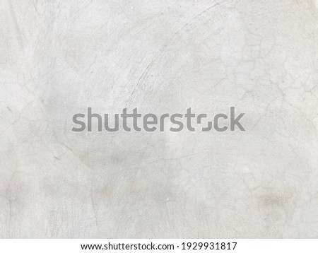 Modern raw grunge cement wall with scratch line texture. Loft style of concrete house or building wall. Softness gray cement wall surface for background structure work.Weathered concrete pattern wall.