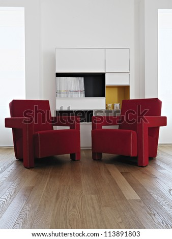 modern re armchair in living room with wood floor