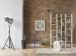 modern reading corner behind natural brick wall living room interior