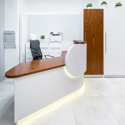 Modern reception area with brown wooden and white elements