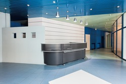 Modern reception in a factory, grey counter