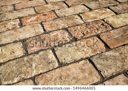 modern reconstruction of a pedestrian road built of tiles and stones with cobblestones, close-up of a part of the roadway