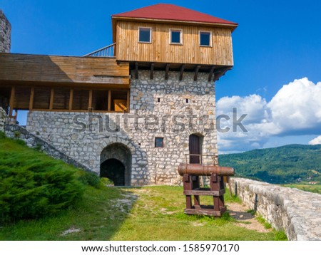 Modern reconstruction of the observation post on the fortress Gradina. Medieval cannon next to the fortress walls facing the city of Doboj. - Image