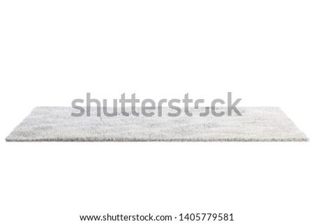 Modern rectangular light gray rug with high pile on white background. 3d render