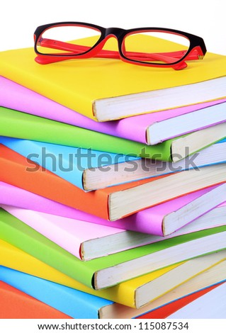 Modern red and black fashion eye glasses and colorful books isolated on white background