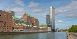 Modern red brick residential and commercial high rise buildings along Spoorweghaven waterfront in Rotterdam