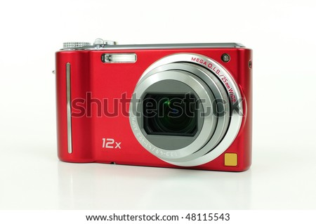 Modern red compact high zoom digital camera over white