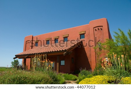 Modern Red Winery with Bright Blue Sky