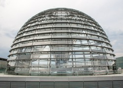 Modern Reichstag dome structure covered in glass panels in Berlin, Germany