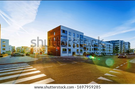 Modern residential apartment and flat building exterior and outdoor. New luxury house and home complex and street with road. City Real estate property and condo architecture. Empty background
