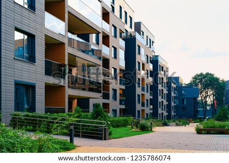Modern residential apartment house home building complex and outdoor facility concept.