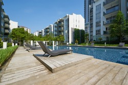 Modern residential buildings with outdoor facilities, Facade of new low-energy houses .