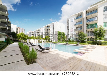 Modern residential buildings with outdoor facilities, Facade of new low-energy houses . #693025213