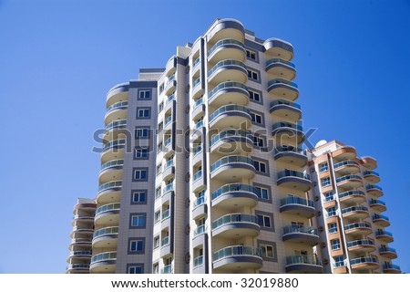 modern residential district with beautiful glass balconies on a background blue sky