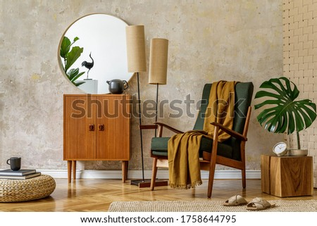 Modern retro composition of living room interior with design armchair, pouf, tea pot on the tray, plant, plaid, carpet, decoration and elegant presonal accessories in wabi sabi concept. Foto stock ©