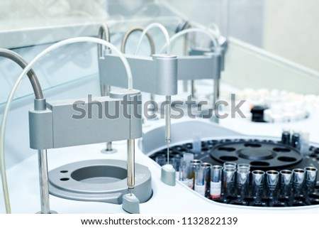 Modern robotical machine for centrifuge blood and urine testing. Medical equipment for automatic biochemical analysis of blood and serum.