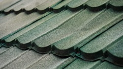 Modern roof with synthetic material very light captured in selective focus