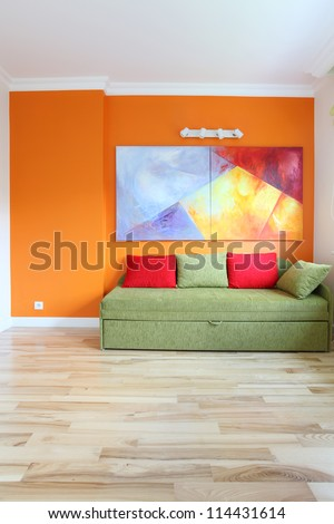 Modern room with colorful wall and sofa