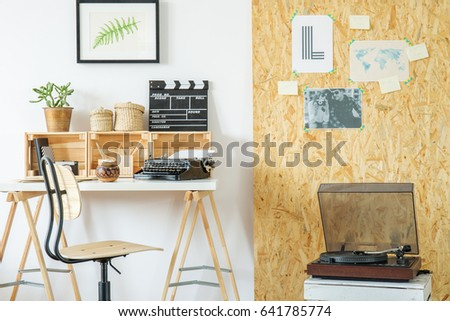 Modern room with desk, record player, posters and osb board #641785774