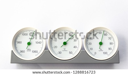 modern, round barometer, thermometer, hygrometer. Analog device for measuring humidity, temperature and atmospheric pressure.