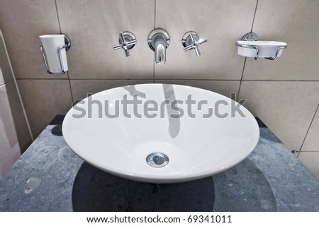 modern round hand wash basin with wall mount holders