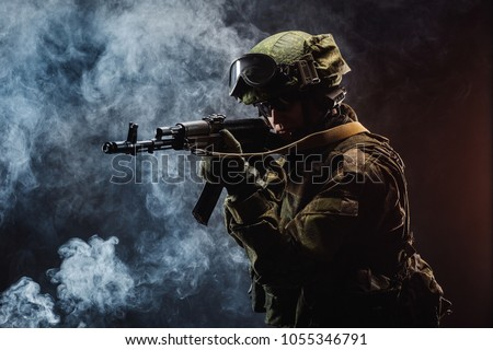 Modern russian special forces soldier with rifle on dark background. army, military and people concept