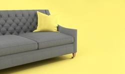 Modern scandinavian classic gray sofa with yellow, gray pillow on wooden legs on yellow background. Pantone color of year 2021. Illuminating and Ultimate gray. Furniture, interior object, Fabric sofa