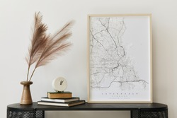 Modern scandinavian home interior with design wooden commode, mock up poster map, feather in vase, book and personal accessories in stylish home decor. Template.