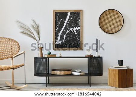 Modern scandinavian living room interior with mock up poster frame, design commode, leaf in vase, rattan armchair, book and elegant accessories in stylish home decor. Template.
