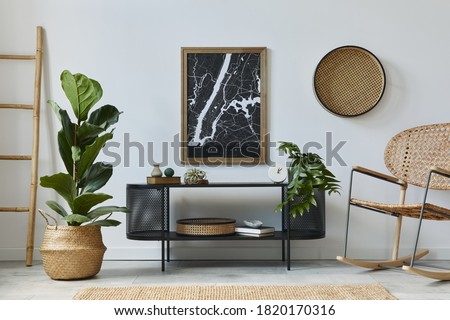 Modern scandinavian living room interior with mock up poster frame, design commode, plants, rattan armchair, book and elegant accessories in stylish home decor. Template.