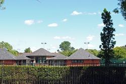 Modern School Building seen against Blue Sky