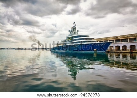 Modern scientific research or tourism ship docked in a pier with a violent storm approaching
