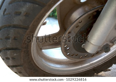Modern scooter wheel with a brakes #1029226816