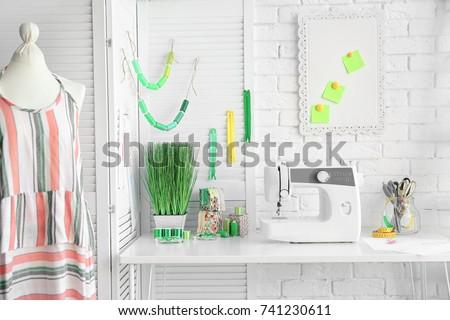 Modern seamstress workshop interior #741230611