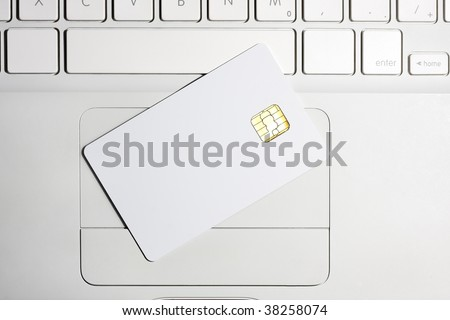 Modern security. White empty smart card close-up on laptop.