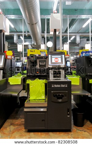 Modern self checkout machine in supermarket store