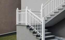 Modern self-supporting staircase with granite top and white lacquered aluminium railing