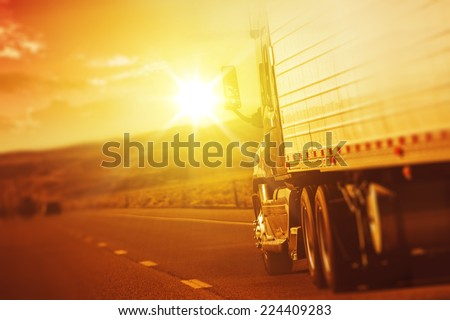 Modern Semi Truck in Motion. American Highway Trucking. Summer on the Highway. #224409283