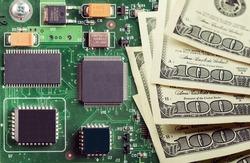 Modern semiconductor circuit board and 100 dollar bill.