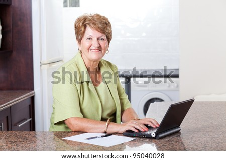 modern senior woman using laptop computer at home