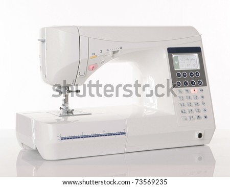 Modern sewing machine - stock photo