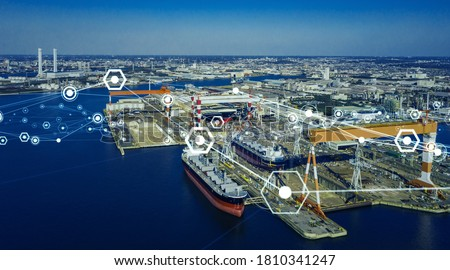 Photo of  Modern shipyard aerial view and communication network concept. Logistics. INDUSTRY 4.0. Factory automation.