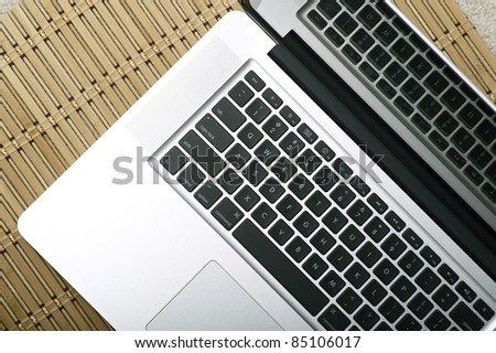 Modern Silver Notebook - Laptop / Top View Photo. Silver Body and Black Keyboard. Technology Photo Collection. Horizontal Photo