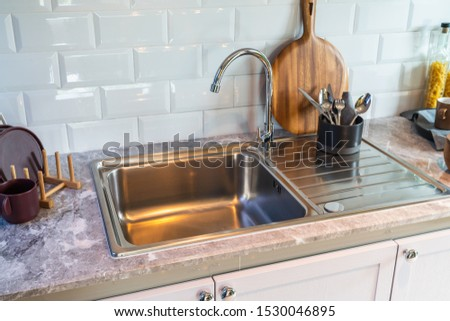 modern sink in modern kitchen room on top counter, interior design decoration concept