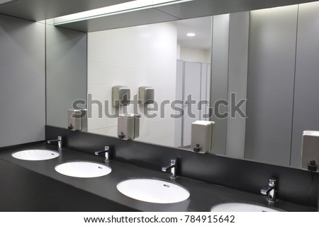 Modern sinks with mirror in public toilet