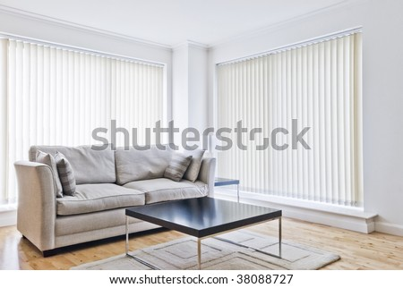modern sitting room with designer sofa and coffee table Stock photo ©