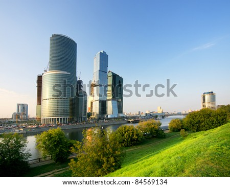 Modern skyscrapers over park at sunset. Moscow. Russia