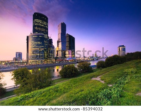 Modern skyscrapers over park at sunset. Moscow. Russia - stock photo